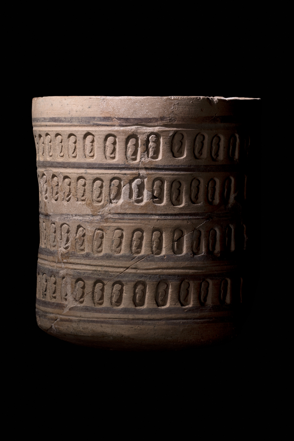 a meroitic pot with rows of incised cobras