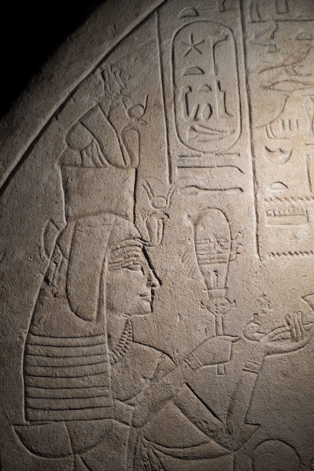detail of an ancient egyptian woman on a limestone stela