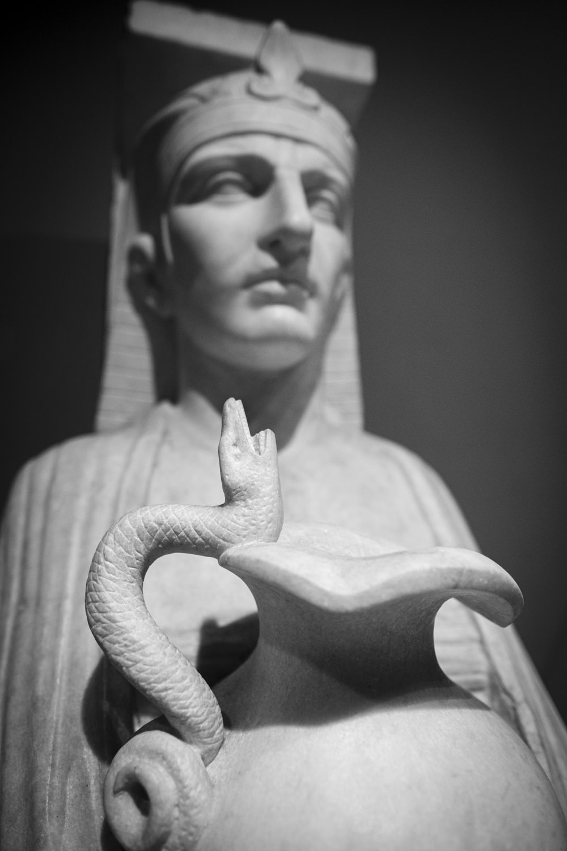 a roman egyptian marble statue of a pharaoh